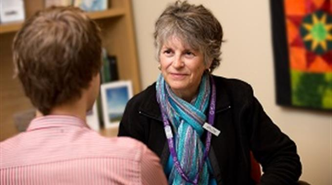 Photo of counsellor talking to a patient